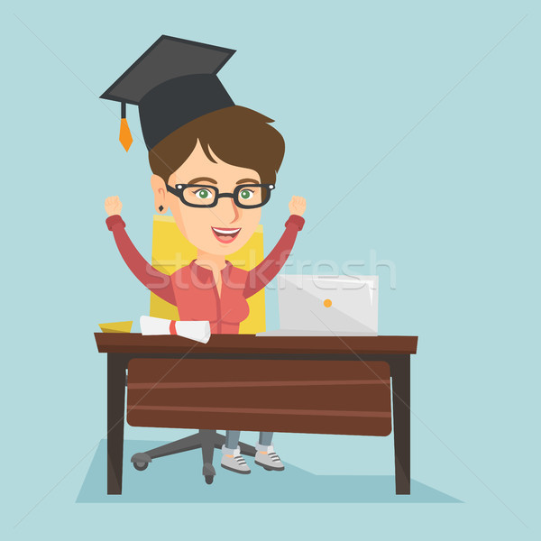 Girl sitting at the table with laptop and diploma. Stock photo © RAStudio
