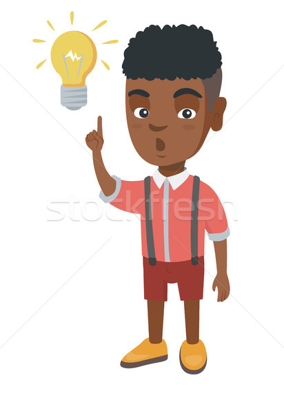 African little boy pointing at the lightbulb. Stock photo © RAStudio
