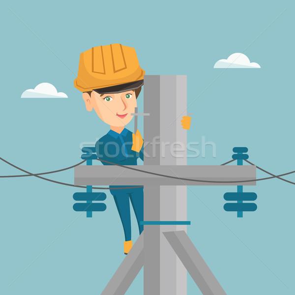 Elettricista lavoro elettrici potere polo giovani Foto d'archivio © RAStudio