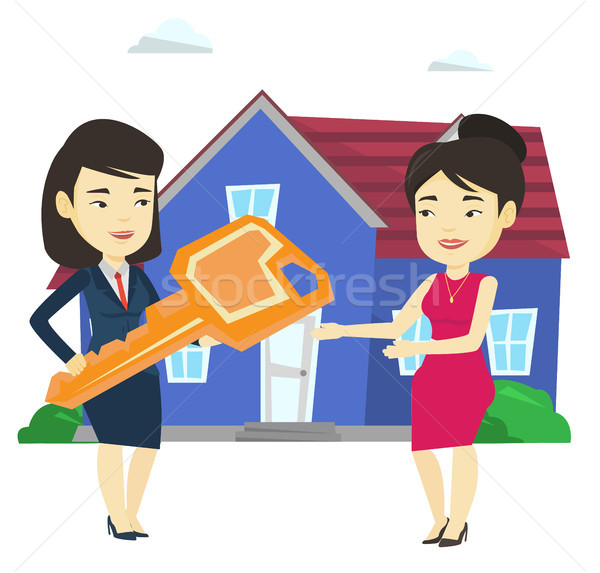 Agente immobiliare chiave proprietario asian casa Foto d'archivio © RAStudio