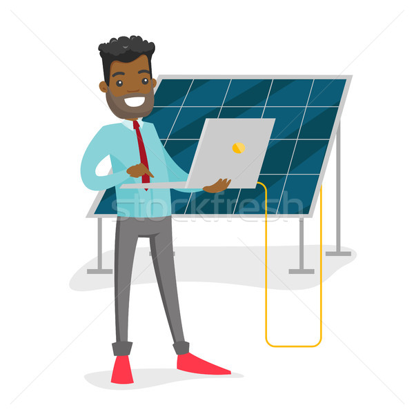 Engineer of solar power plant working on a laptop. Stock photo © RAStudio