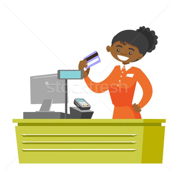 Młodych kasjer karty kredytowej kasa supermarket Zdjęcia stock © RAStudio