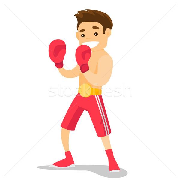 Caucasian white boxer training in boxing gloves. Stock photo © RAStudio