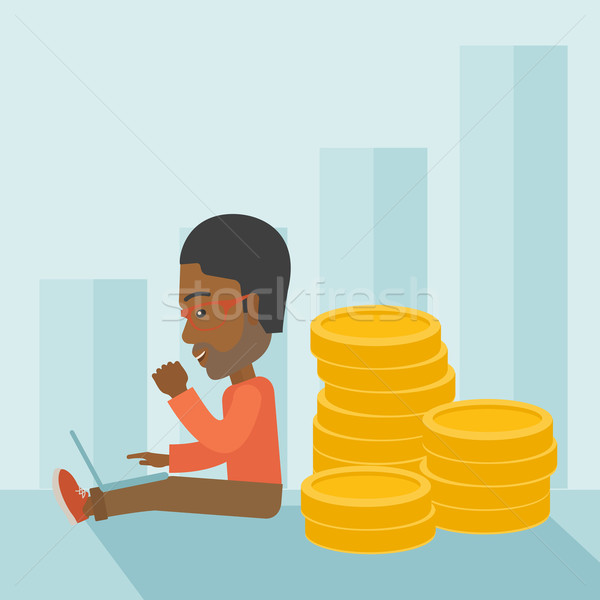 Successful black businessman sitting with a pile of gold. Stock photo © RAStudio
