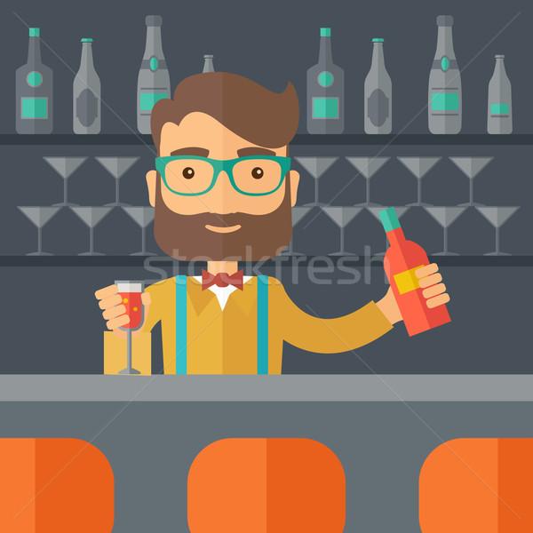 Bartender at the bar holding a drinks. Stock photo © RAStudio