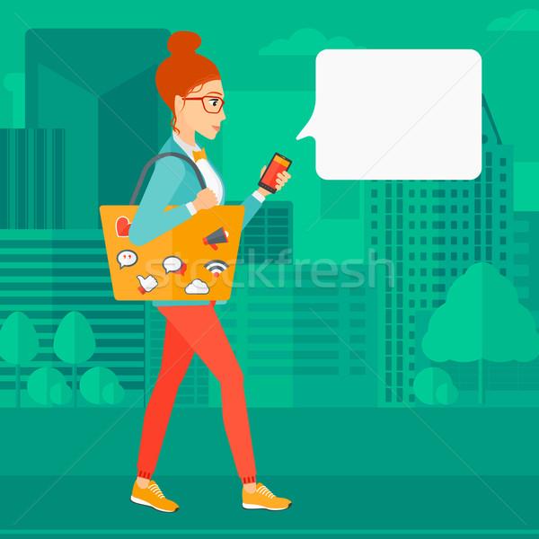 Nő sétál okostelefon táska tele közösségi média Stock fotó © RAStudio