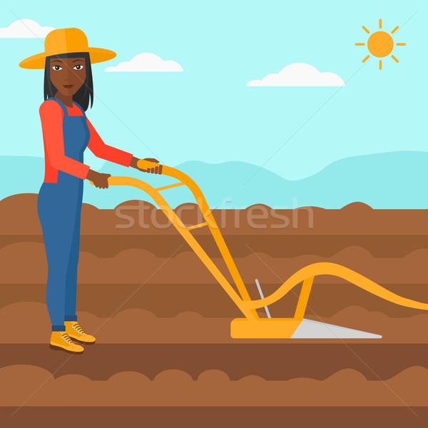 Farmer on the field with plough. Stock photo © RAStudio