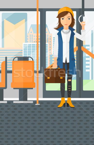Mulher em pé dentro transporte público mala vetor Foto stock © RAStudio