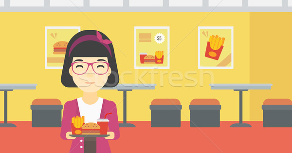Woman with tray full of fast food. Stock photo © RAStudio