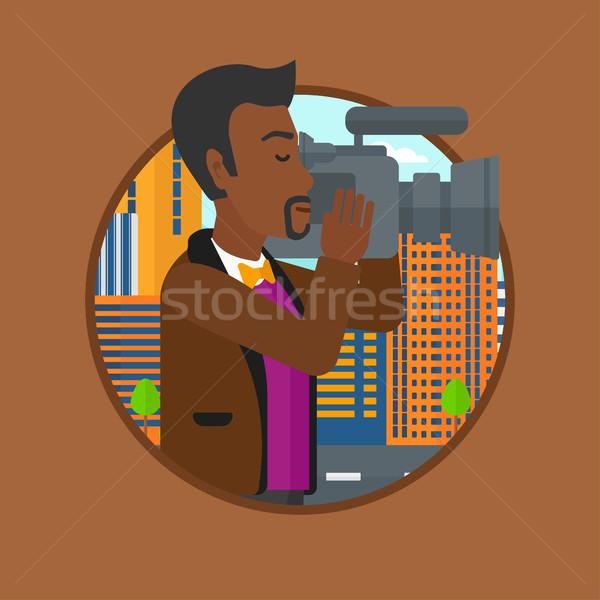 Cameraman with video camera vector illustration. Stock photo © RAStudio