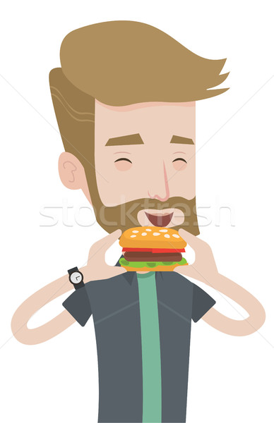 Homme manger hamburger barbe heureux Photo stock © RAStudio