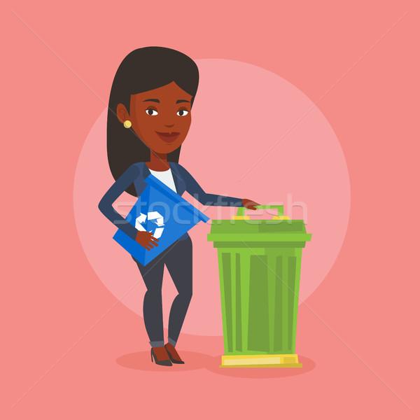 Mulher reciclar cesto de lixo jovem Foto stock © RAStudio