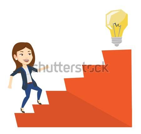 Zakenvrouw lopen naar boven idee lamp zakenvrouw Stockfoto © RAStudio