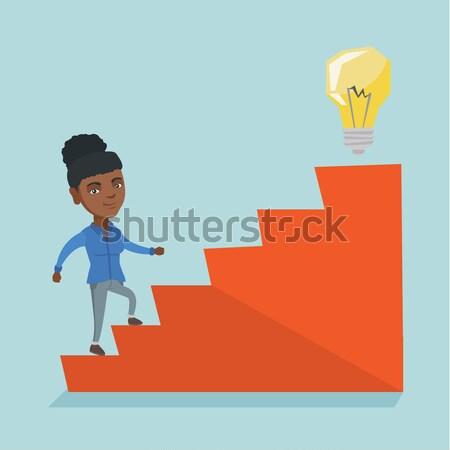Zakenvrouw lopen naar boven idee lamp asian Stockfoto © RAStudio