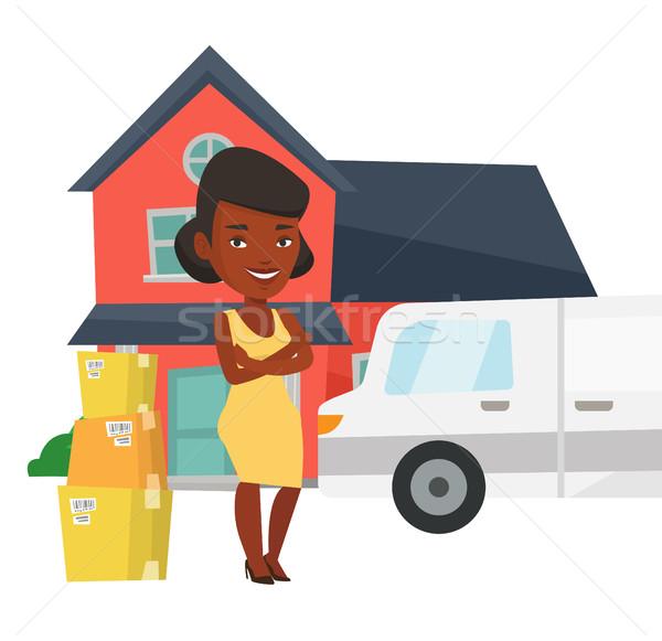 Nő mozog ház háztulajdonos karton dobozok Stock fotó © RAStudio