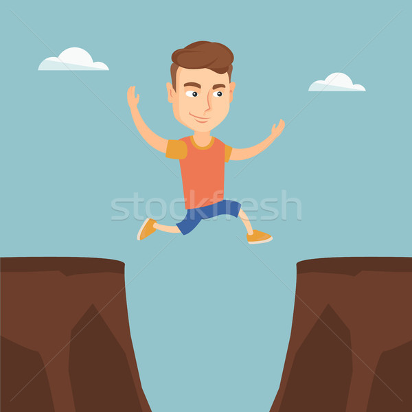 Sportsman jumping over the cliff. Stock photo © RAStudio