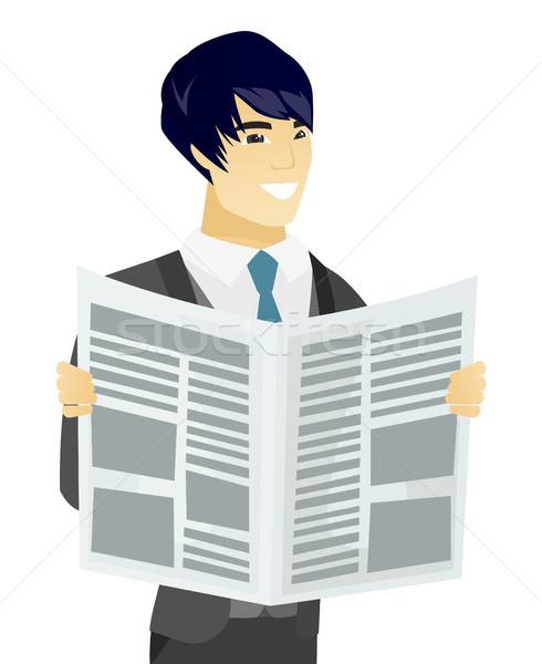 Young asian groom reading newspaper. Stock photo © RAStudio