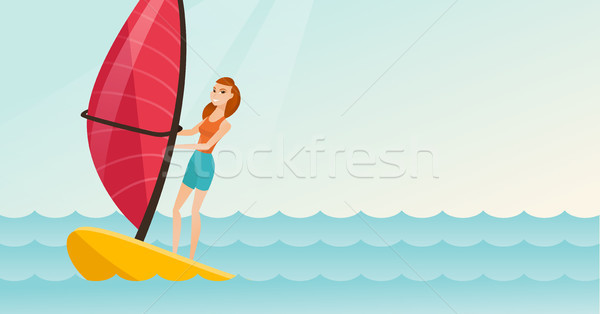 Stock photo: Young caucasian woman windsurfing in the sea.