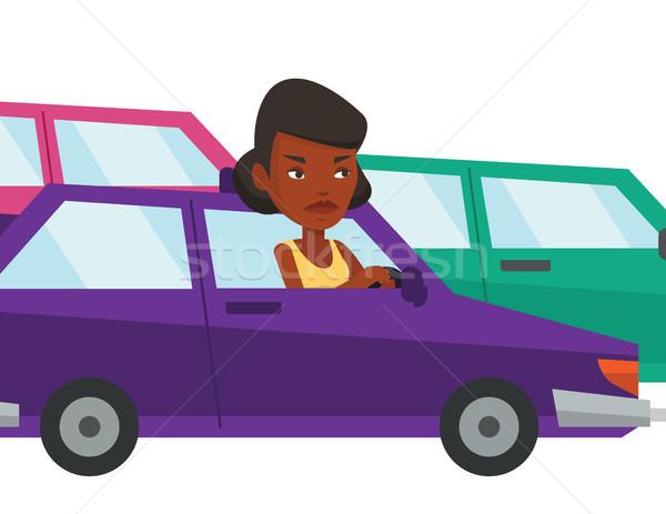 Angry african woman in car stuck in traffic jam. Stock photo © RAStudio