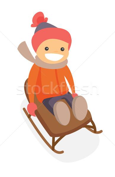Happy caucasian white boy enjoying a sleigh ride. Stock photo © RAStudio