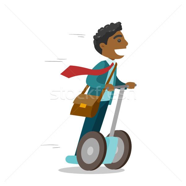 Férfi lovaglás elektromos moped fiatal üzletember Stock fotó © RAStudio