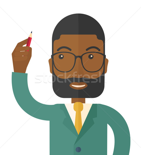 Black man holding a pen. Stock photo © RAStudio