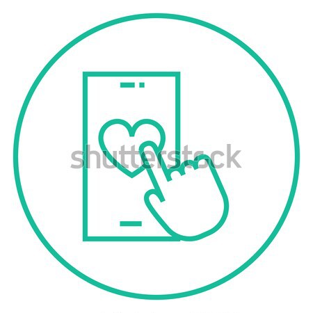 Smartphone with heart sign line icon. Stock photo © RAStudio
