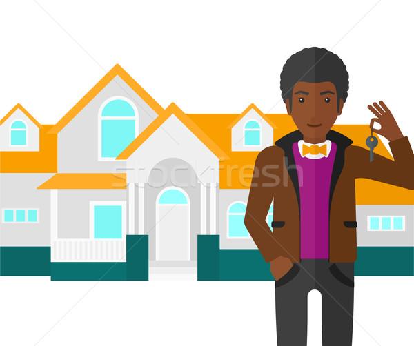 Agent immobilier clé maison vecteur design Photo stock © RAStudio