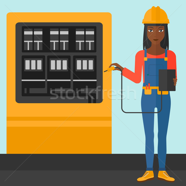 Electrician with electrical equipment. Stock photo © RAStudio