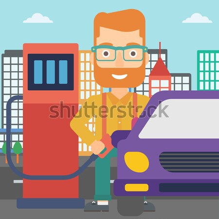 Homme remplissage up carburant voiture ville Photo stock © RAStudio