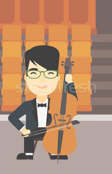 Férfi játszik cselló ázsiai fiatalember csellista Stock fotó © RAStudio
