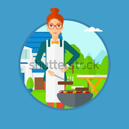 Nő főzés hús barbecue grill udvar fiatal nő Stock fotó © RAStudio