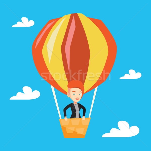 Young woman flying in hot air balloon. Stock photo © RAStudio