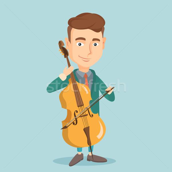 Adam oynama viyolonsel genç mutlu kafkas Stok fotoğraf © RAStudio