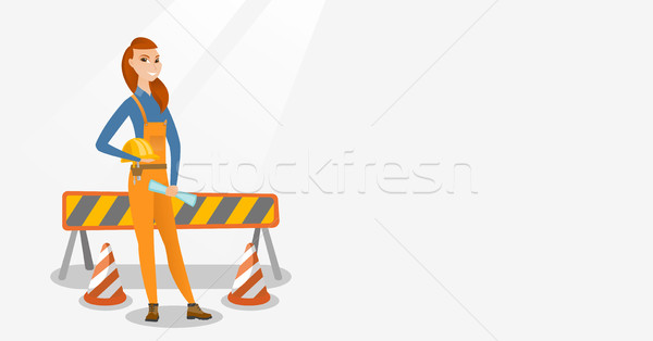 Engineer with hard hat and blueprint. Stock photo © RAStudio