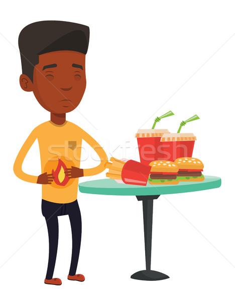 Man lijden maagzuur jonge man maagpijn fast food Stockfoto © RAStudio