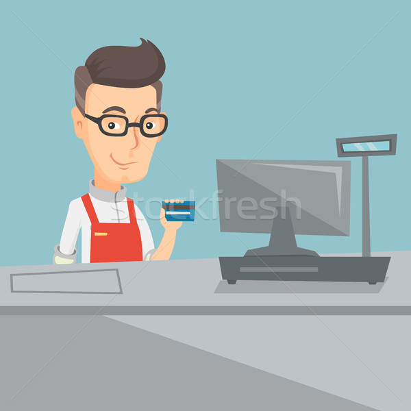 Cashier holding a credit card at the checkout. Stock photo © RAStudio
