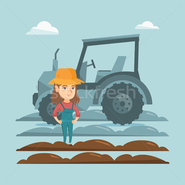 Farmer standing on the background of tractor. Stock photo © RAStudio