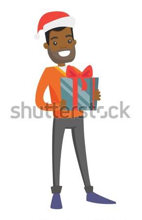 молодые человека Рождества подарок улыбаясь Сток-фото © RAStudio