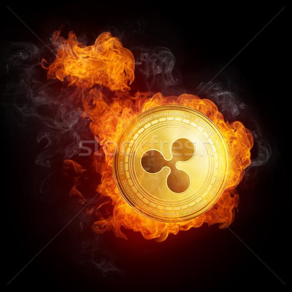 Golden Ripple coin falling in fire flame. Stock photo © RAStudio