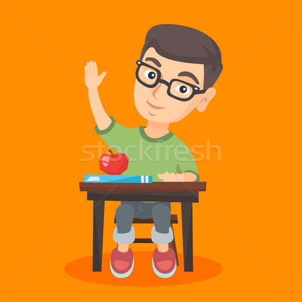 Scolaro seduta desk mano Foto d'archivio © RAStudio
