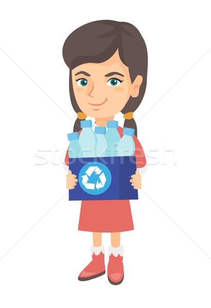 Girl holding recycling bin full of plastic bottles Stock photo © RAStudio