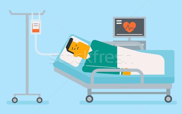 Caucasian white man lying in hospital bed. Stock photo © RAStudio