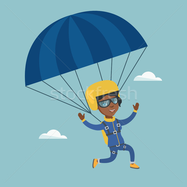 Young african skydiver flying with a parachute. Stock photo © RAStudio