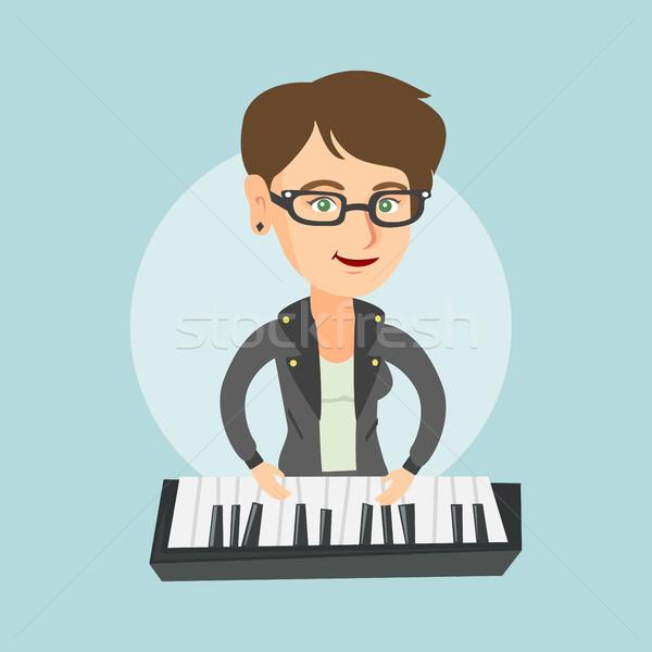 Jóvenes caucásico mujer jugando piano músico Foto stock © RAStudio