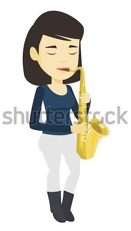 музыканта играет саксофон азиатских женщину Сток-фото © RAStudio