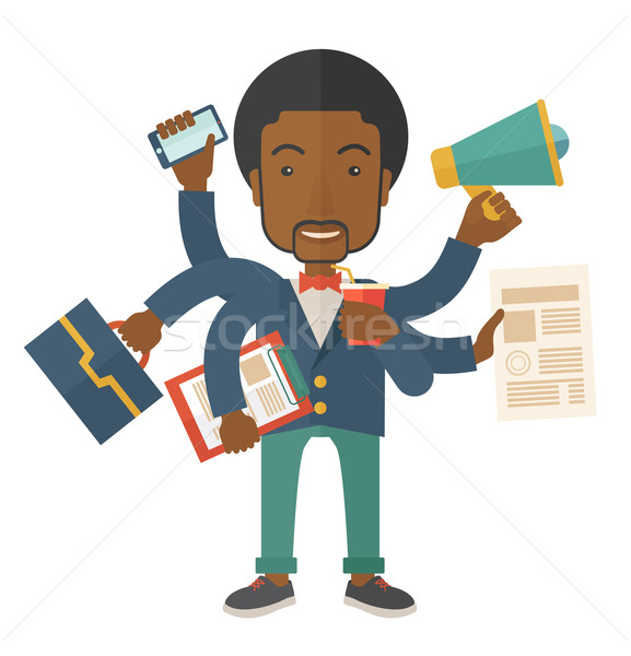 Young but happy african employee doing multitasking office tasks. Stock photo © RAStudio