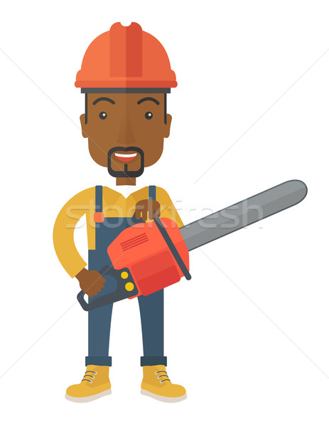Stock photo: Black Lumberjack cuts a tree by chainsaw.