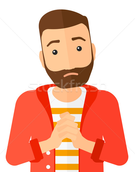 Regretful man with clasped hands. Stock photo © RAStudio