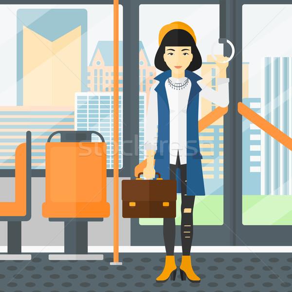 Woman standing inside public transport. Stock photo © RAStudio